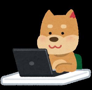 パソコンを使う犬