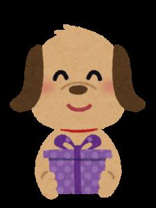 プレゼントを持つ犬